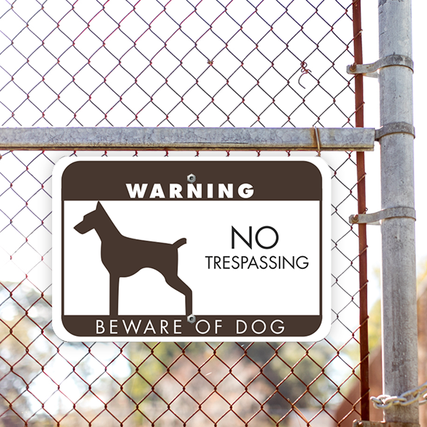 No Trespassing Beware of Dog Horizontal Sign Lifestyle Photo Outside