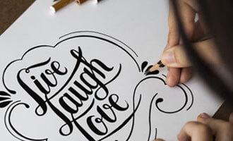 Intricate hand lettering on paper