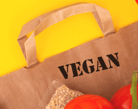 Vegan stamp on paper grocery bag