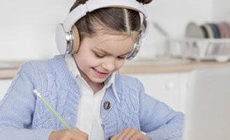child doing homework at desk