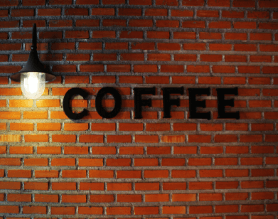 Brick Wall with the Word Coffee